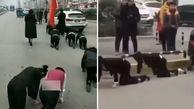 چهار دست و پا راه بردن کارمندان زن در خیابان!