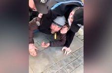 دستگیری خشونت آمیز یک مرد به همراه کودک خردسالش+ فیلم
