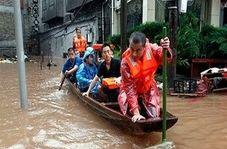 قایق سواری در کوچه پس کوچه های برخی شهرهای چین به خاطر سیل+ فیلم