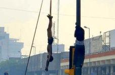 فیلمی دلخراش از آویزان کردن پیکر نوجوان ۱۶ ساله در میدان الوثبه بغداد